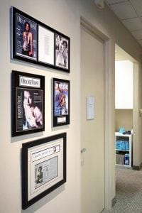Magazine Covers Framed on Wall In Office
