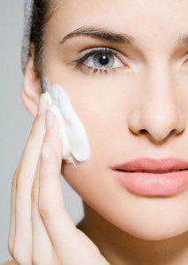 Woman-applying-skincare-213x300